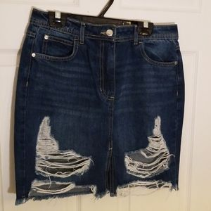 Distressed blue jeans skirt